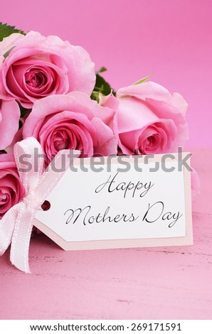 Happy Mothers Day Pink Roses on Vintage style distressed pink wood table.