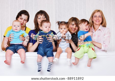 Happy mothers playing with their babies - stock photo