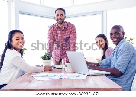 Happy multi ethnic business people in meeting room at creative office - stock photo