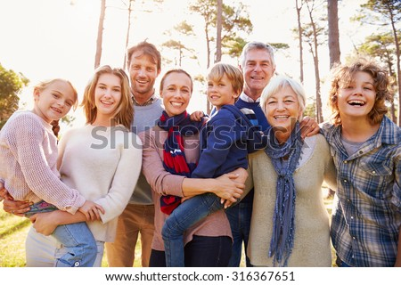 Happy multi-generation family portrait in the countryside - stock photo