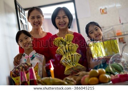 Happy multi generations Asian family celebrate Chinese new year at home