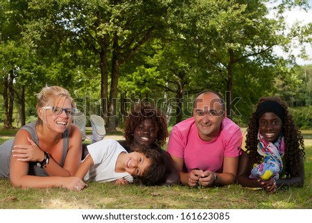 Happy multicultural family having a nice summer day - stock photo