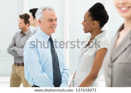 Happy Multiethnic Business People Talking During a meeting - stock photo