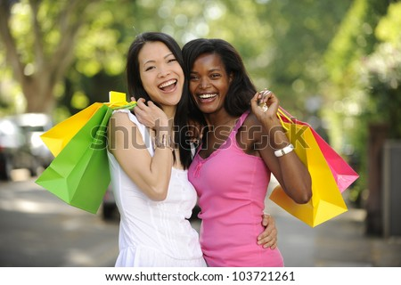 happy multiethnic friends with shopping bags - stock photo