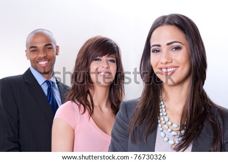 Happy multiracial business team, three young smiling people. - stock photo