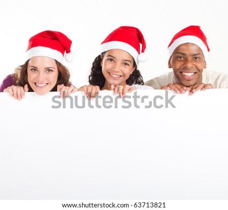 happy multiracial family holding white board - stock photo