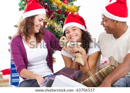 happy multiracial family with gifts at Christmas - stock photo