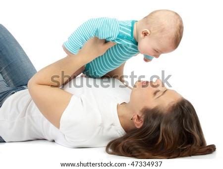 Happy mum plays with the small child a white background.