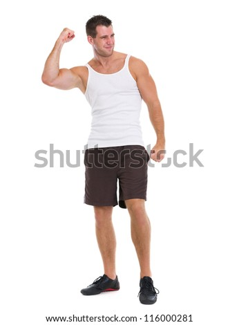 Happy muscular man rejoicing success