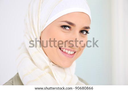 Happy Muslim beautiful woman smiling