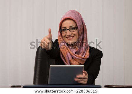 Happy Muslim Business Woman With Thumbs Up Gesture - stock photo