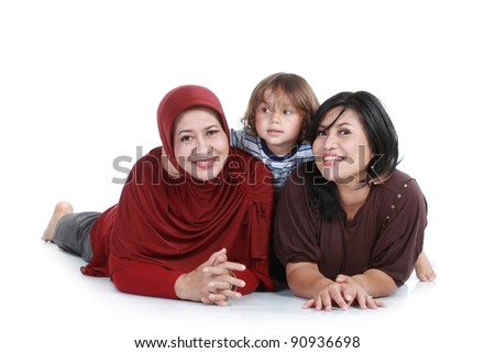 happy muslim family lying on floor. isolated over white background