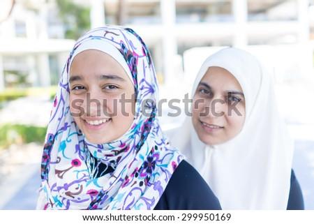 Happy Muslim girls - stock photo