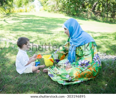 Happy Muslim mom with little son