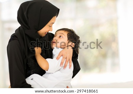 happy muslim mother and baby boy - stock photo