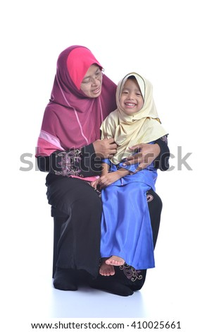 Happy Muslim Mother and her daughter, isolated on white background - stock photo