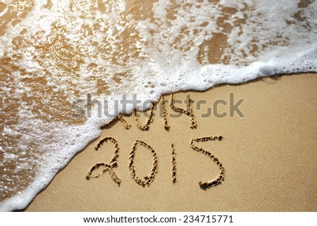 Happy Near Year concept 2015 replace 2014 on the sea beach