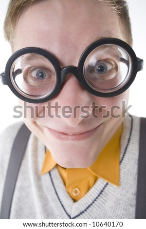 Happy nerd in funny glasses. Smiling and looking at camera. Front view, white background - stock photo