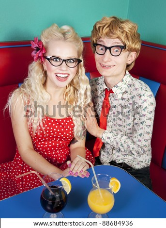 Happy nerdy couple - stock photo