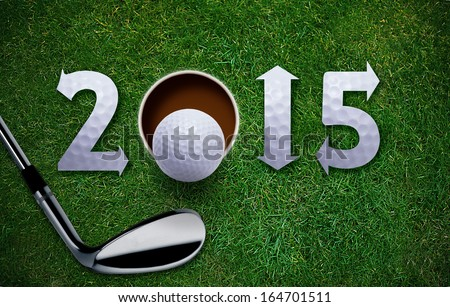 Happy New Golf year 2015,  Golf ball and putter on green grass, the same concept available for 2016 and 2017 year. - stock photo