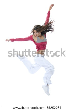 Happy new modern slim hip-hop style woman dancer jumping isolated on a white studio background