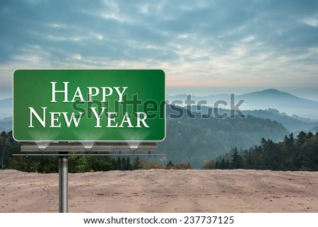 Happy new year against misty landscape - stock photo