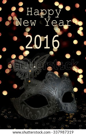 Happy New Year and Carnival mask - stock photo