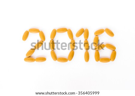 Happy New Year 2016 arranged from pills; Year of health concept, Happy and healthy - stock photo