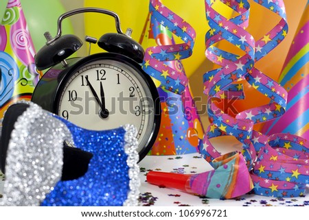 Happy new year background with carnival mask serpentines confetti and balloons - stock photo