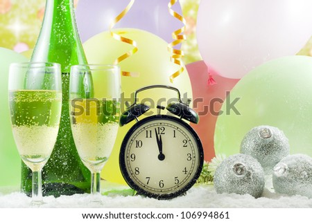 Happy new year background with glass of champagne clock and balloons
