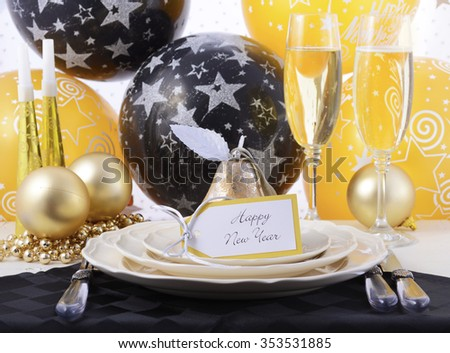 Happy New Year black, gold and white dinner party table place setting.  - stock photo