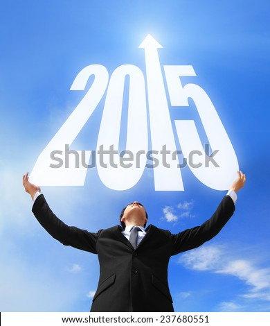 Happy new year - Business man holding 2015 new year imagination with sky and cloud, asian - stock photo