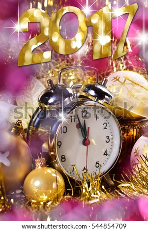 happy new year 2017 card with alarm clock and shining golden decorations