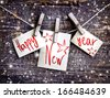 Happy New Year card with  snow on wooden background - stock