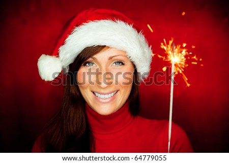 Happy new year celebrating woman holding sparkles - stock photo