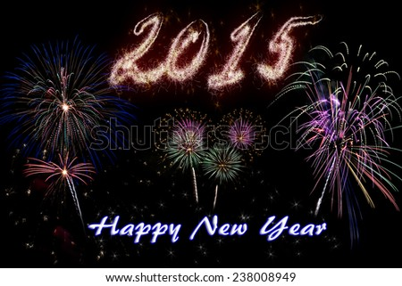 Happy New Year 2015 celebration concept with sparkly text on beautiful fireworks in the night. - stock photo