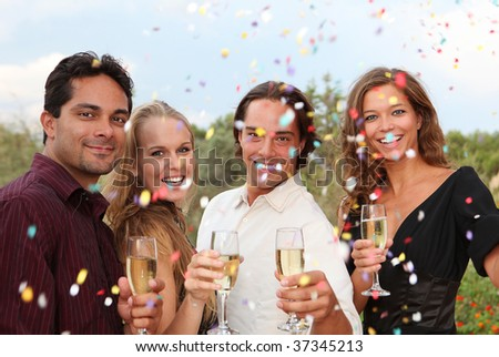 happy new year celebration with champagne and confetti - stock photo