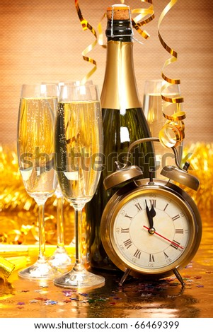 Happy New Year - Champagne and clock - stock photo