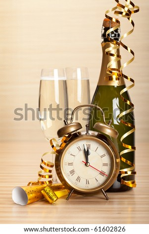 Happy new year - champagne and party decoration - stock photo