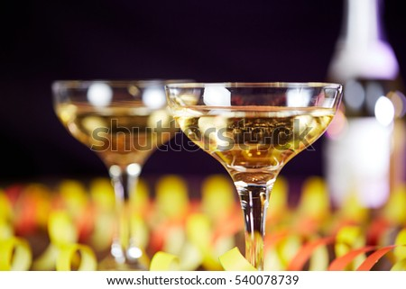 Happy New Year Champagne Sparkling Wine glasses and paper ribbons