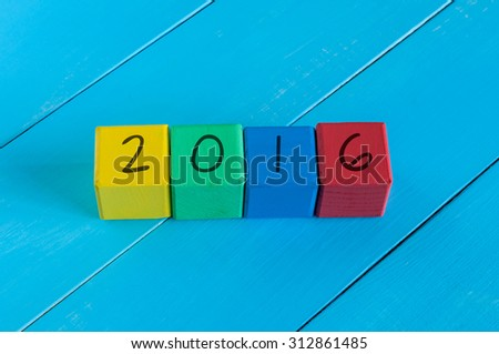 Happy new 2016 year. Colorful design.  Numeral 2016 on children's colourful cubes or blocks - stock photo