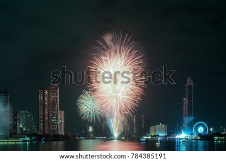 Happy new year 2018, Colorful of fireworks on the river at night with city background, Bangkok, Thailand.