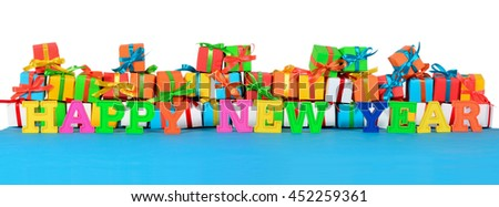 Happy New Year colorful text on the background of varicolored gifts