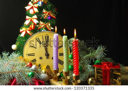 Happy New Year. Composition with old clock, candles and decorated Christmas tree - stock photo