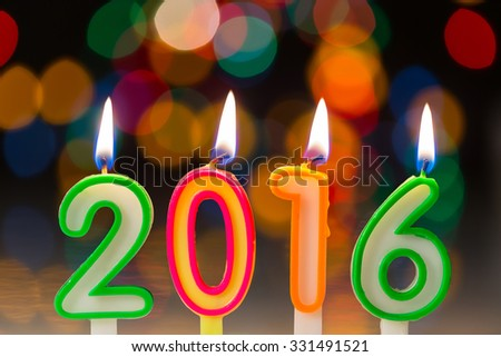 happy new year 2016 concept,burning candles on colorful bokeh background