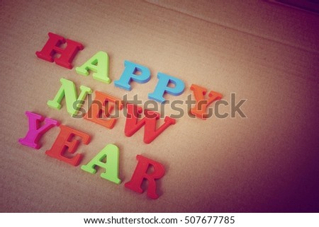Happy New Year concept. Letters on background