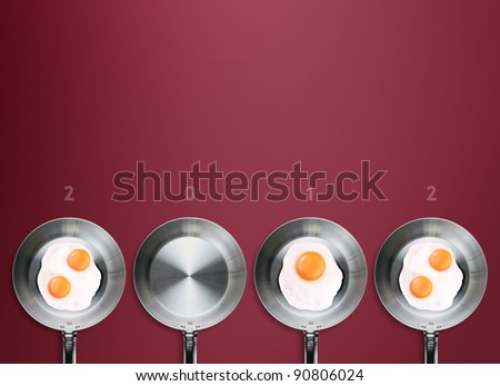 Happy new year 2012, conceptual images Fried eggs in a frying pans creating 2012 year number. - stock photo