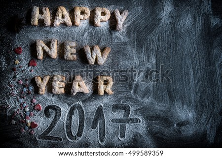 Happy New Year 2017 cookies on the dark background with blank space