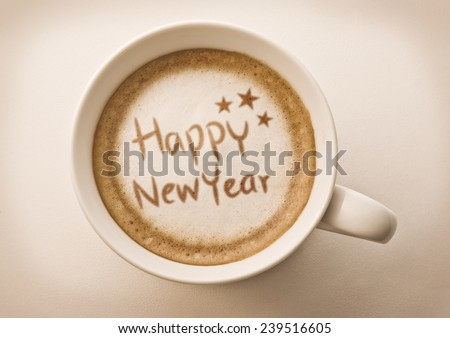 Happy New Year drawing on latte coffee cup - stock photo