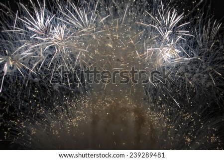 Happy new year fireworks on black background - stock photo